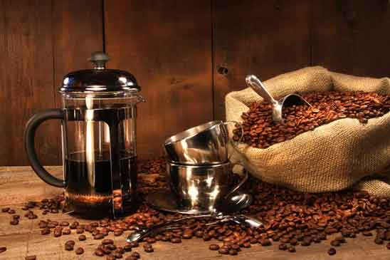 sack of whole coffee beans with french press